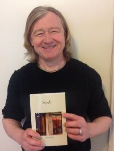 "Steve Prentice holding an advance copy his new book, ""Mouth."""